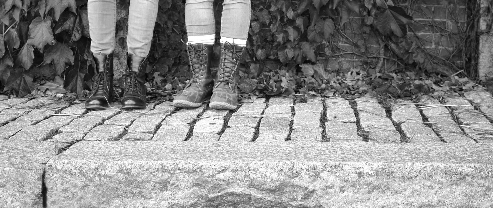 Meg and Elise standing on a brick sidewalk