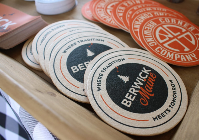 Co-branded coasters on merchandise table